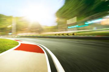 Wall Mural - Motion blurred racetrack,sunset scene