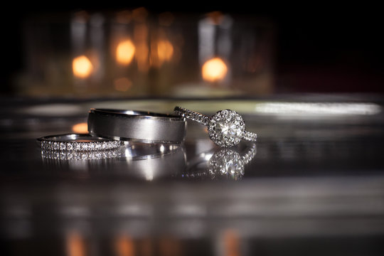 Wedding rings stacked on beautiful background 2.