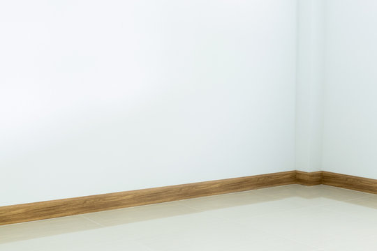 empty room interior, white tile floor and white mortar wall back