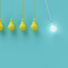 Hanging yellow light bulbs with glowing one different idea on light blue background , Minimal concept idea , flat lay , top
