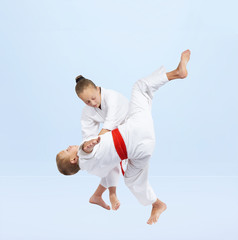 Judo throw are training boy and girl
