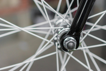 macro detail of a black fork on a fixie bike