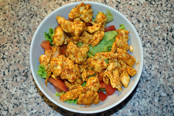 Delicious homemade spicy and healthy chicken salad  for recovery after workout.