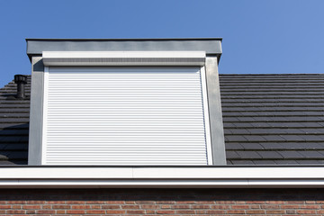 Dormer window with rolling safety  shutter