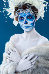 Santa Muerte woman at blue background