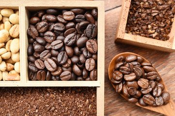 different coffee forms in wooden box and coffee bean in wooden spoon