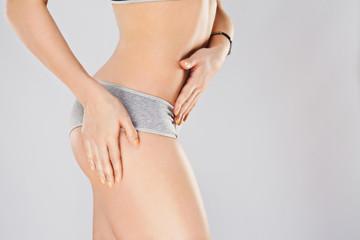 Sportive girl in gray underwear
