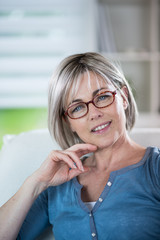 the portrait of a nice mature woman with grey hair and glasses