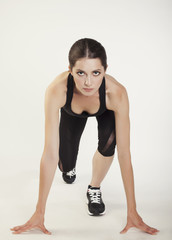 young sport beauty woman in start position isolated