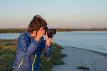 Active woman with camera