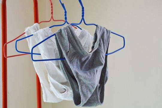 men underwear in hanger on red cloth line at home