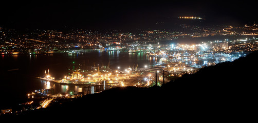 The bay of Novorossiysk by night with an illuminated port and city, Russia