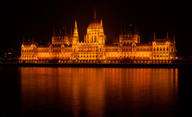 Hungarian parliament building by night isolated and illuminated across the Danube river, Budapest, Hungary