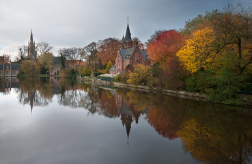 Reflections in a park in autumn in Bruges, Belgium