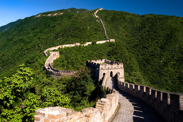 The Great Wall of China on the green mountain slopes, China