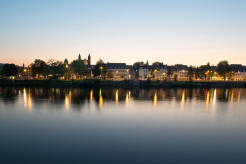 Maastricht across the river during sunset