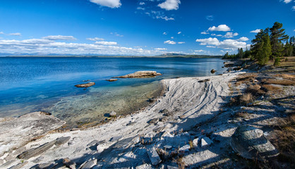 Beach of Yellowstone lake with fishing cone geyser, Yellowstone National Park, USA