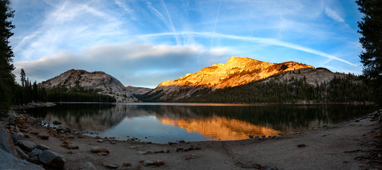 Clear lake with reflection when entering Yosemite NP through the Tioga Pass, USA