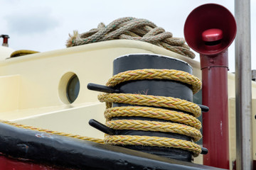 Rope on a bollard on a ship anchored in the port of Amsterdam, The Netherlands
