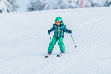 Little boy skiing down the hill