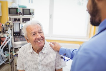 Doctor interacting with patient