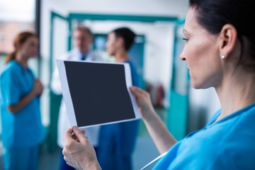 Surgeon examining a report