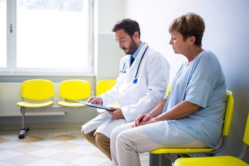 Doctor consulting patient in waiting room