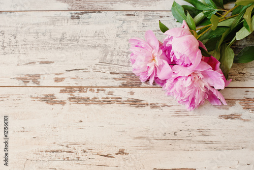 Stunning pink peonies on white light rustic wooden background ...