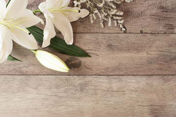 Floral frame with white calla, lilies on wooden background. Styled marketing photography. Copy space. Wedding, gift card, valentine's day or mothers day background