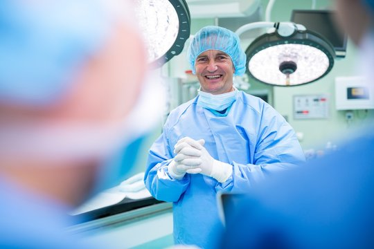Portrait of smiling surgeons standing in operation room