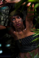 Strong black woman in jungle environment