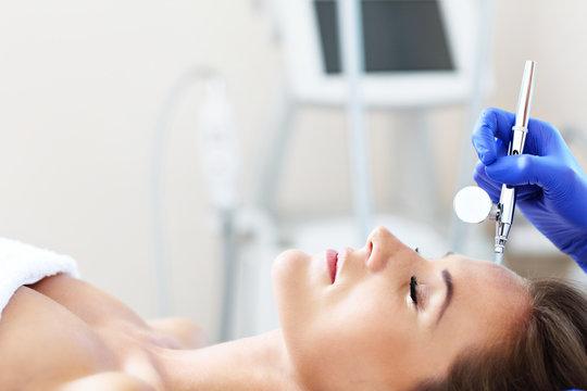 Woman having facial treatment in beauty salon
