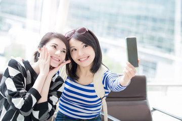 woman take smart phone selfie