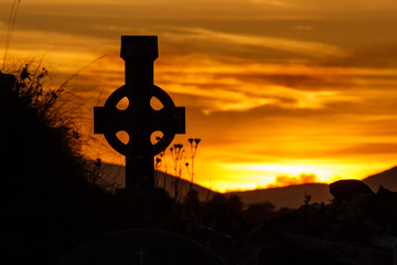 Silhouette of Celtic Cross at Sunset on the Dingle Peninsula, County Kerry, Ireland