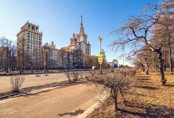 Wide angle view of long avenue of spring sunny campus of Moscow University