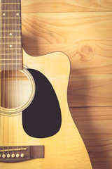 Acoustic guitar on wood background , vintage