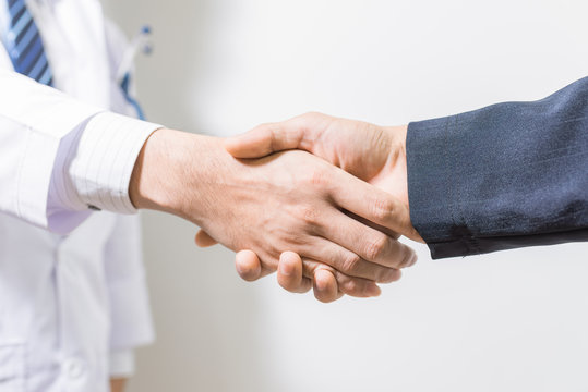 doctor and her lawyer shaking hands
