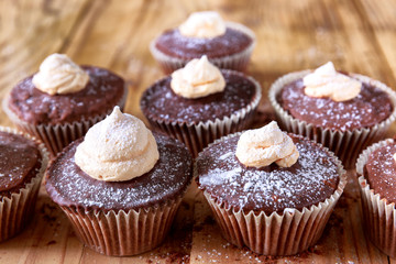 Chocolate cocoa muffins with meringue on the top