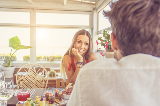 Portrait of a lover woman dating with perfect smile