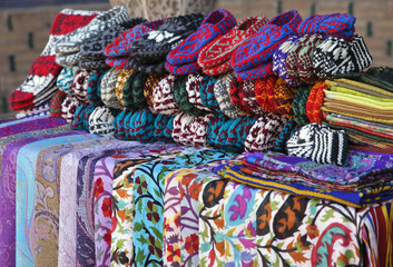 Scarves and knitted slippers in a street market, Uzbekistan