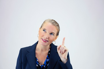 Business Woman Holding Up Index Finger Looking Left