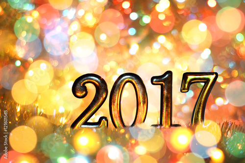 new year christmas background of colored holiday lights gold numbers 2017