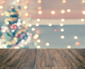 Wood plank with sparkle bokeh Christmas theme in vintage tone. I