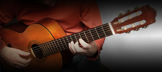Acoustic guitar hands close up