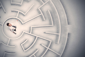 Business man trapped in a circular maze Wall mural