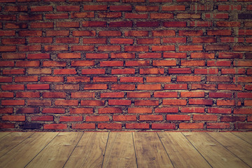 wood floor with old brick wall background.