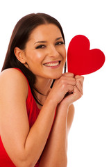 Woman in love wearing red dress holding red heart sending messag
