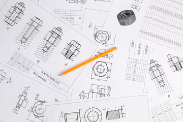 Pencil on background of engineering drawings. Science, mechanics and mechanical engineering