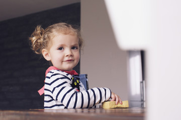 Little girl helping with housework, portrait