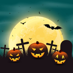 Halloween background with pumpkins in the graveyard, and a bright yellow moon night.